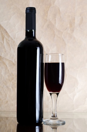 Red wine glass on vintage a background Stock Photo - 11210362