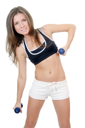 The girl does exercises with dumbbells isolated Stock Photo - 11313843