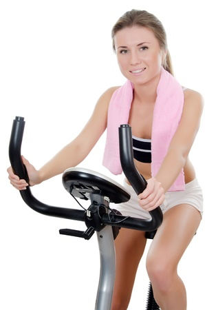The girl is engaged on a velosimulator Stock Photo - 11313838