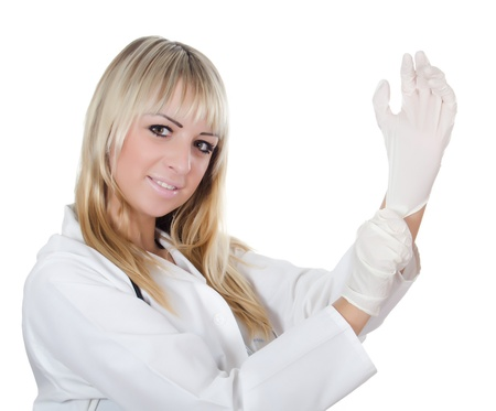 gloves nurse: The beautiful doctor dresses gloves