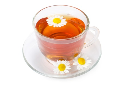 Glass cup with fragrant a camomile tea photo