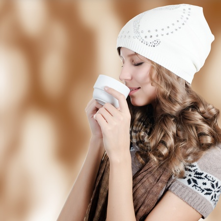 The beautiful girl with a coffee cup photo