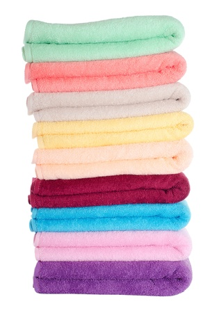 laundry pile: The combined  color towels isolated on white