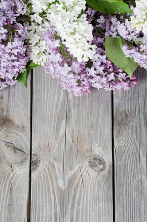 lilac background: The beautiful lilac on a wooden surface