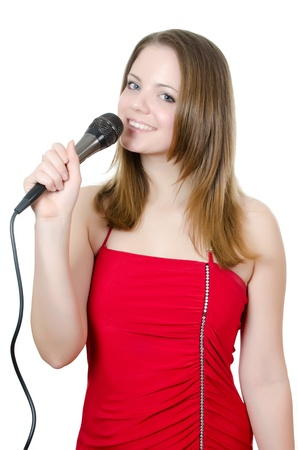 Girl with a microphone isolated on white Stock Photo