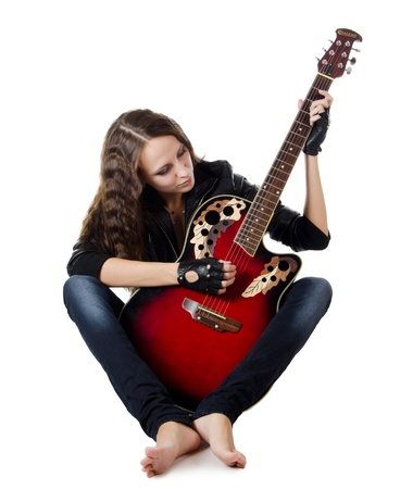 woman guitar: Girl in leather jacket with a guitar