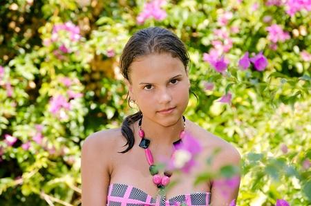 Portrait of the young girl in bikini photo
