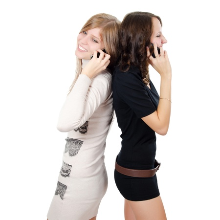 Two girls speak on the phone isolated Stock Photo - 11708514