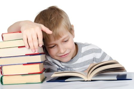 Boy reads the book isolated on white photo