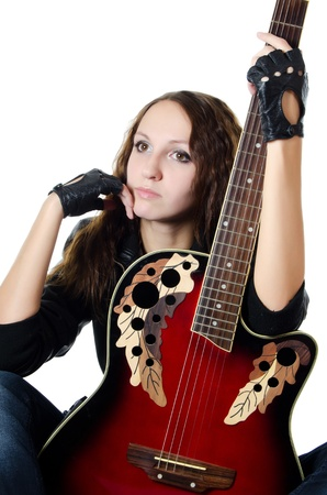 Girl in leather jacket with a guitar photo