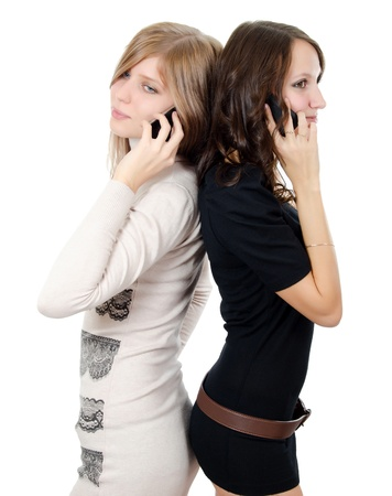 Two girls speak on the phone isolated photo
