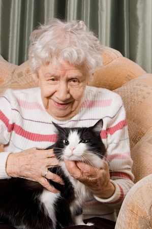 dedication: The grandmother with a cat on sofa