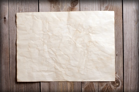 The old paper on a wooden surface photo