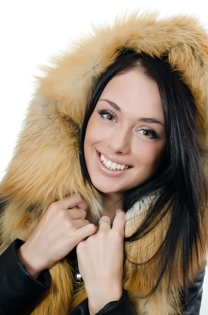 The beautiful girl in a fur hood Stock Photo - 11708863