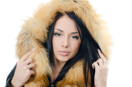 The beautiful girl in a fur hood photo