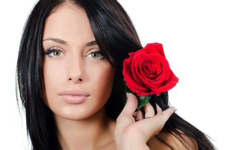 Girl with beautiful hair with red rose photo
