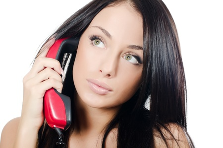 The beautiful girl with red phone isolated Stock Photo - 11708832