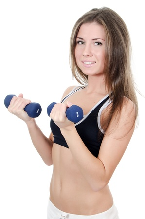 The girl does exercises with dumbbells isolated photo