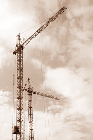 The elevating crane against the cloudy sky photo
