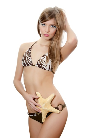 The young beautiful girl with starfish isolated photo