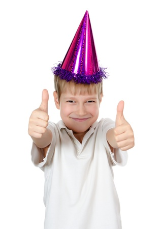 birthday boy: Boy in a party hat isolated on white