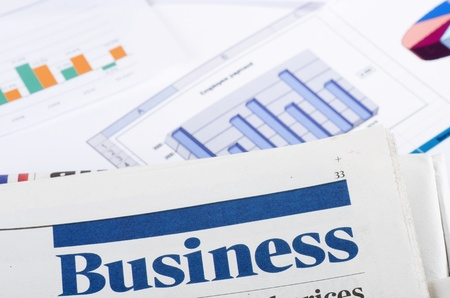 crisis management: Graphs, charts, business table. The workplace of business people. Stock Photo