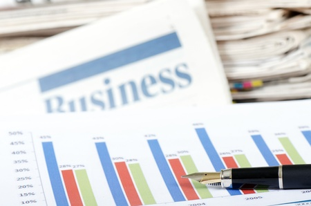 Business newspaper with chart photo