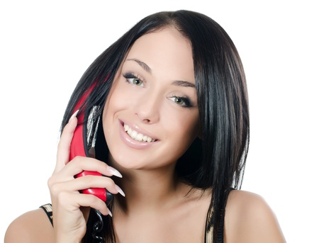 The beautiful girl with red phone isolated photo
