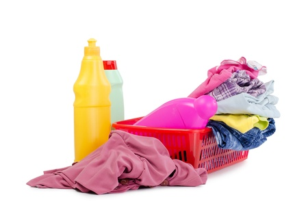 Heap of pure clothes with washing-up liquids photo