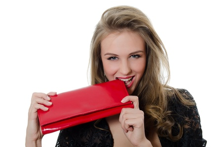 The beautiful girl with a red handbag Stock Photo - 12455675