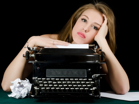 article writing: The beautiful girl at a typewriter. Retro