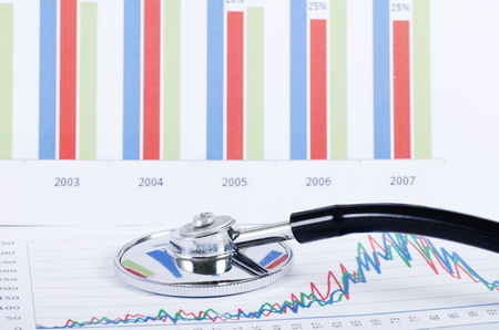 market analysis: Stethoscope on stock chart - market analysis Stock Photo