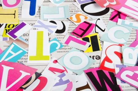 Letters which have been cut out from newspapers close up photo