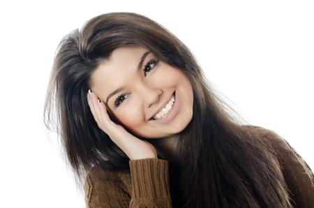 The beautiful girl in a brown sweater photo