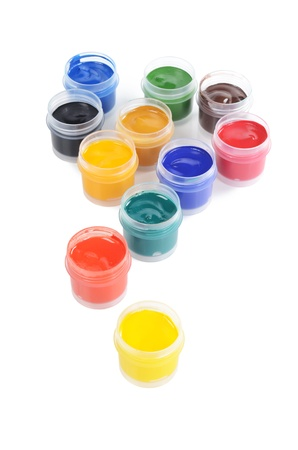 Jars with colour paints on white background photo