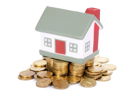 Toy small house and coins . concept photo