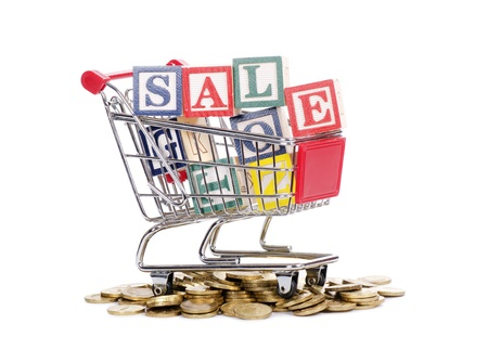 The coins, shopping cart and word SALE Stock Photo - 12458254