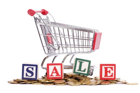 The coins, shopping cart and word SALE photo