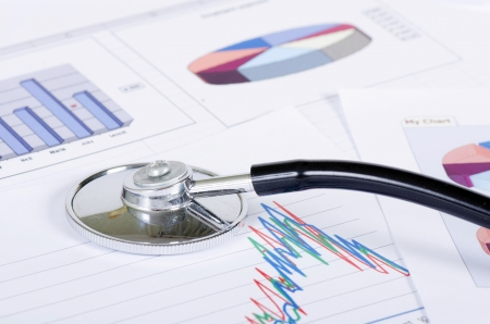 cardiac care: Stethoscope on stock chart - market analysis Stock Photo