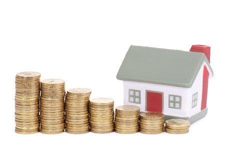 economic rent: Toy house and coins in the form of the diagram