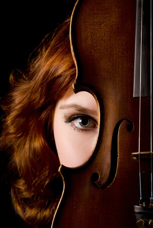 stringed: Beautiful girl with a violin on black