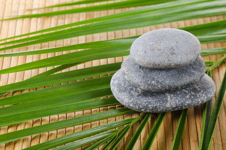The spa a stone on bamboo background photo