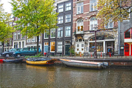 gabled house: Amsterdam canals in  autumn weather