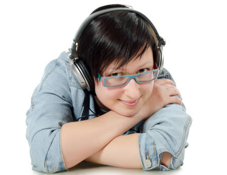The girl listens to music through ear-phones photo
