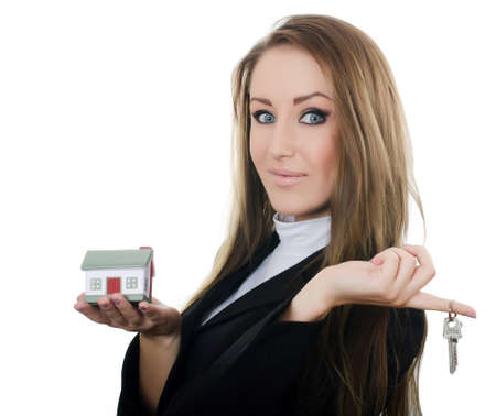 Business woman with small model of house photo