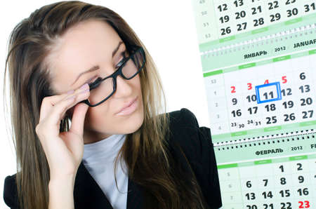 saturday: The business woman with a calendar isolated Stock Photo