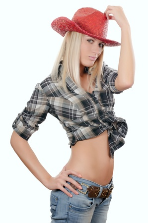sexy cowgirl: The beautiful girl in a cowboys hat
