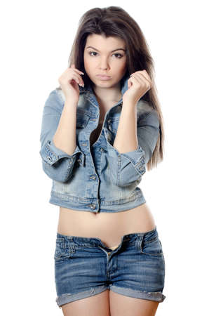 The beautiful girl in jeans shorts isolated photo