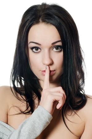 quiet adult: segreto - Giovane ragazza con un dito sulla bocca Archivio Fotografico