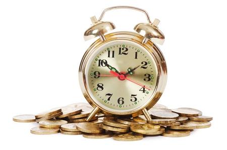 Alarm clock and money isolated on white Stock Photo - 12855891